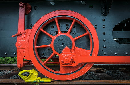 red and black train wheel closeup photography