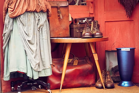 pair of brown leather boots on brown wooden table