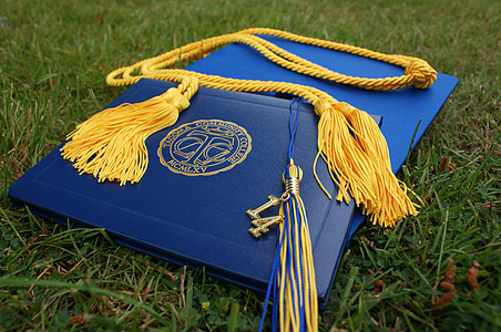 blue graduation book and hatg