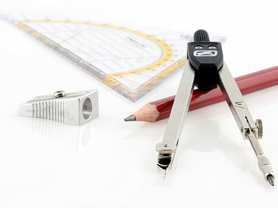 red pencil beside grey and black graphing compass and grey sharpener