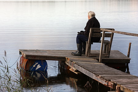woman sitting on chair on dock