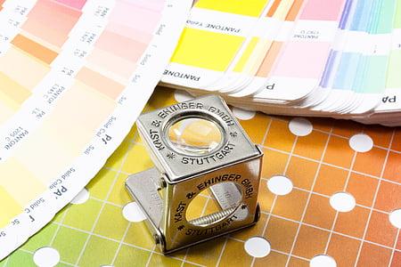 gray Kast & Ehinger magnifying glass