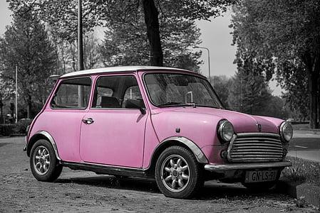 selective color photography of pink 3-door hatchback