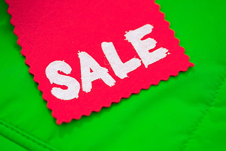 red clothe with Sale text overlay on green surface