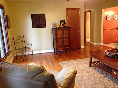 rectangular brown wooden coffee table near brown sofa chair