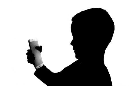 boy holding smartphone