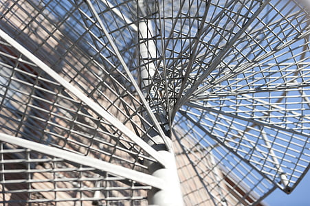 white metal spiral staircase during daytime