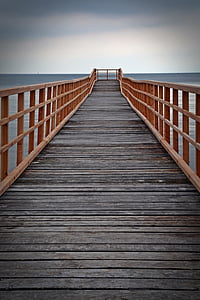 black and brown wooden dock near blue body of water under sky during daytime
