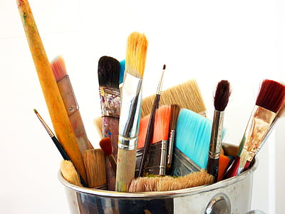 assorted brushes on stainless steel bucket