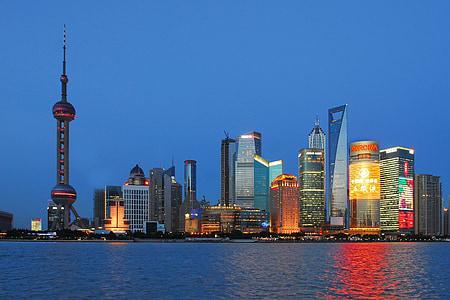 Shanghai skyline beside body of water