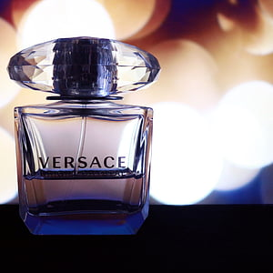 focus photography of Versace fragrance bottle