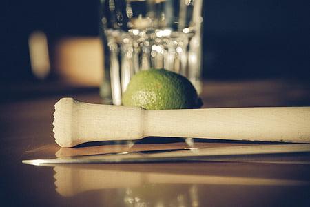 lime behind beige wooden tool