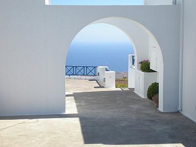 white concrete arch gateway