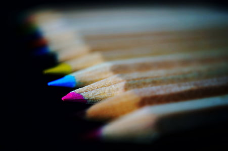 selective focus photography of color pencils