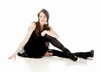 woman wearing black sleeveless dress and boots