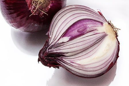 sliced onion on white surface