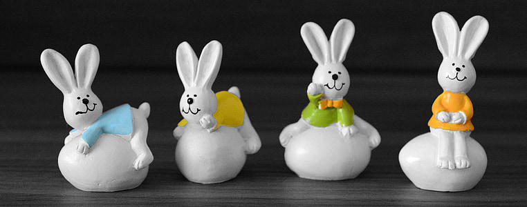 four rabbits figurines