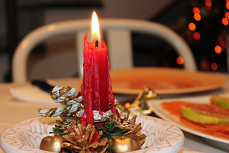 lighted red taper candle