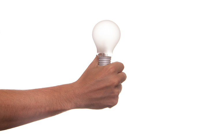 Royalty-Free photo: Person holding light bulb | PickPik