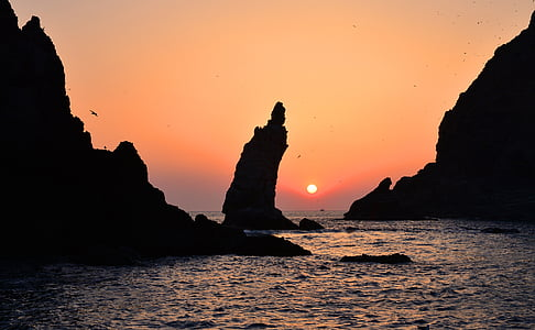 silhouette of islet rock