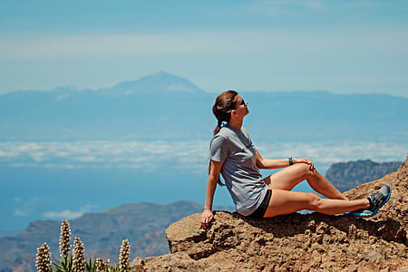 hiking woman laying on rock formation