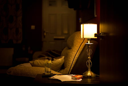 turned on brown table lamp