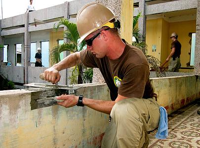 man constructing building