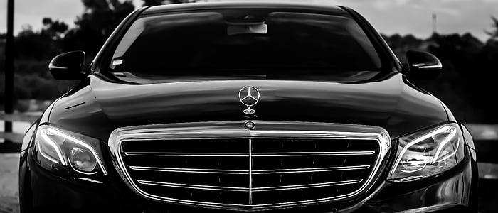 black Mercedes-Benz sedan