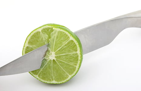 sliced lime with gray knife