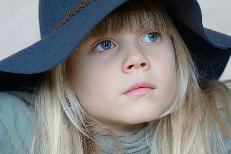 close up photo of girl wearing sun hat