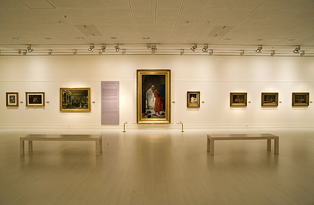 assorted-painting displayed in white room