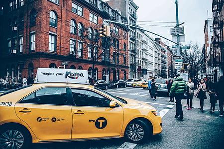 yellow sedan in middle of cross road