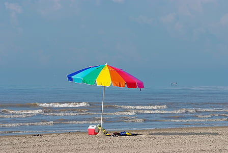 multicolored beach umbrella near beach