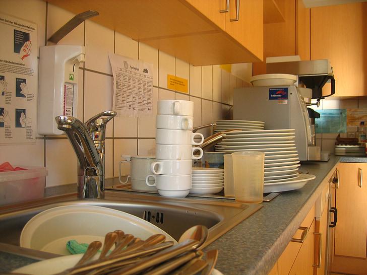 white dinnerware items beside sink in kitchen