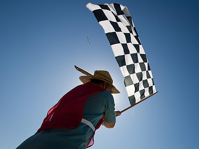 man carrying black and white checkered flag