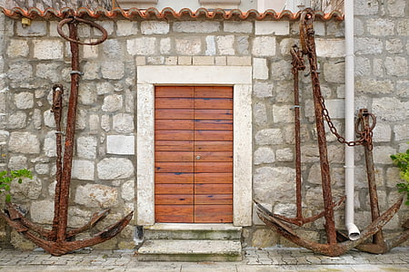 brown anchor near brown wooden door