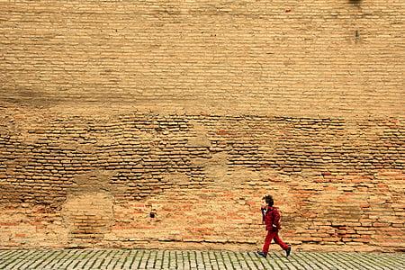 boy running near wall