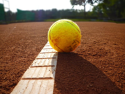 photography of yellow baseball during day time