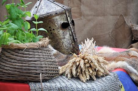 brown rice grain on table beside wicker pot