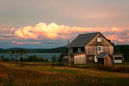 photo of wooden house during sunset