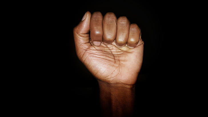 human fist with black background