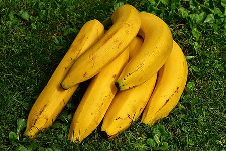 bananas on green field