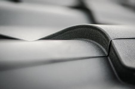 closeup photo of gray corrugated galvanized sheet
