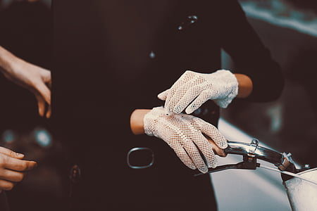 person wearing pair of white gloves