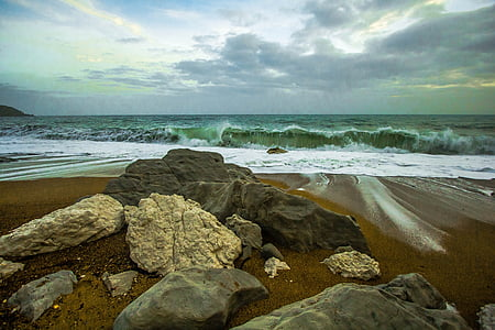 landscape photography of water waves hitting rocks