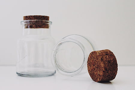 clear glass bottle with cork lid