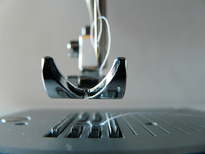 shallow focus photography of sewing machine part
