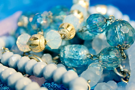 blue gemstones in shallow focus photography