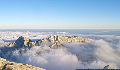 white mountain and clouds
