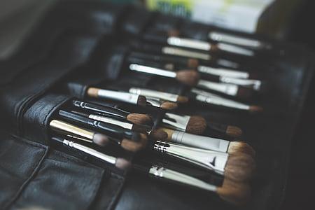 makeup brush in black leather bag